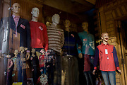 Mannequins in the window of a clothing business displaying western-style clothes in modern Luxor, Nile Valley, Egypt. More peculiar is the grinning face on the mosel, far right, whose open-mouthed expression looks ridiculous. Other clothing being modelled is stylishly Western/European.