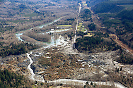 Highway 530 (top) disappears into the massive mudslide that destroyed Oso, Washington March 31, 2014. Recovery teams struggling through thick mud up to their armpits and heavy downpours at the site of the devastating landslide in Washington state are facing yet another challenge - an unseen and potentially dangerous stew of toxic contaminants. REUTERS/Rick Wilking (UNITED STATES)