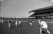 22/04/1962<br /> 04/22/1962<br /> 22 April 1962<br /> Gaelic Weekly S.F. Tournament final, Kildare v. Meath<br /> Kildare's right-half forward, P. Moore, battles his way past Meath defender M. Quinn as another Meath defender, B. McGuirk (left), awaits the outcome during the final at the Gaelic Weekly S.F. Tournament at Croke Park, Dublin, on 22 April 1962.