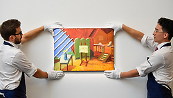 """© Licensed to London News Pictures. 27/09/2019. LONDON, UK.  Technicians present """"Bridlington Studio Interior"""", 1996, by David Hockney (Est. GBP 0.9-1.2m).  Preview of Sotheby's Frieze Week Contemporary Art exhibition at its New Bond Street galleries.  Over 250 works by artists, including Andy Warhol, David Hockney and Jean-Michel Basquiat, will be auctioned on 3 October 2019.  Photo credit: Stephen Chung/LNP"""