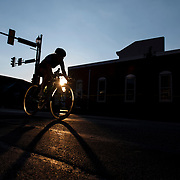 Cyclists compete in the Iron Hill Twilight Criterium in West Chester, Pa. USA. <br /> <br /> *ILLUSTRATION: NOT FOR EDITORIAL USE [TELEPHONE LINES AND POSTS REMOVED FOR COMMERCIAL USAGE]<br /> <br /> www.jackmegaw.com<br /> <br /> 610.764.3094<br /> jack@jackmegaw.com