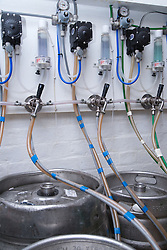 Barrels of beer stored in cellar of bar at Polish Social Club,