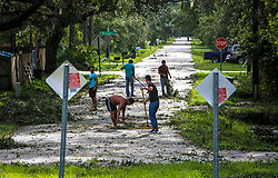 Neighbors help each other clear their road of debris on Hibiscus Road in Kissimmee, Fla. on Monday, September 11, 2017 as residents begin to clean up after Hurricane Irma plowed through the state. Photo by Orlando Sentinel/TNS/ABACAPRESS.COM