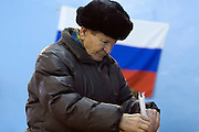 Znamenka, Russia, 02/03/2008..A man votes in front of a Russian flag during the Presidential election that President Vladimir Putin's chosen heir Deputy Prime Minister Dmitry Medvedev is expected to win easily in the first round.