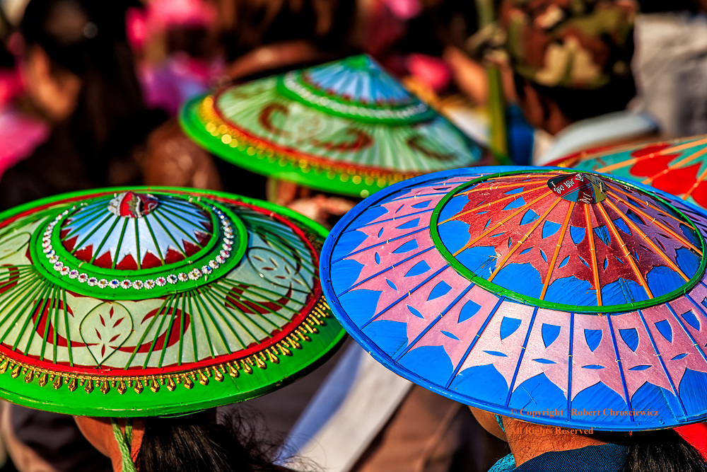 Circular Symmetry: During their National Day celebration the Shan Tribes arrive in traditional dress and colourful bamboo hats, Hsipaw Myanmar.