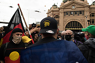 A member of the Far Right Proud Boys is confronted by Invasion Day protesters outside of Flinders Street Station during a march through the city of Aboriginal people and their supporters in Melbourne on Australia Day (which they called, 'Invasion Day'). Australia marks the anniversary of the arrival of the First White Settlers in Australia. (Photo by Michael Currie/Speed Media)