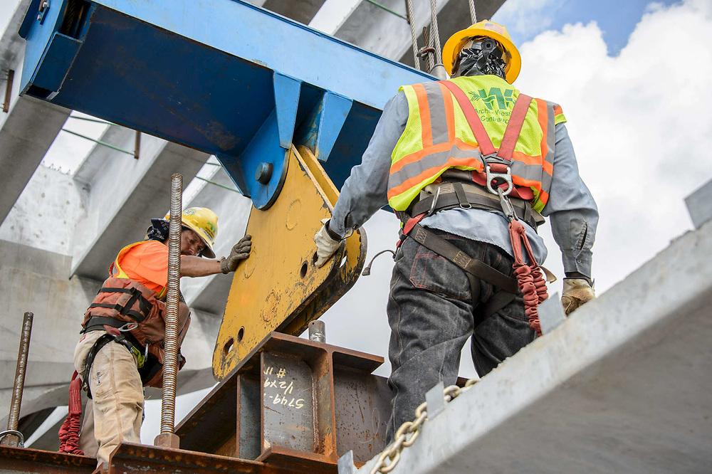Construction workers building the Indian Street Bridge in Stuart Florida