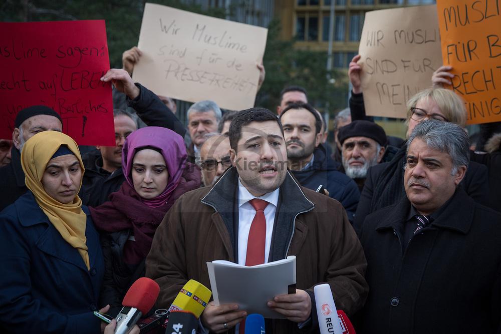 Berlin, Germany - 16.01.2015 <br /> <br /> Demonstration in front of Axel-Springer skyscraper for a peaceful coexistence, for freedom of press & opinion. The rally was part of a nationwide campaign of different mosque communities which took place in front of different media houses. The protest was organized by the Turkish-Islamic Union DITIB. Kai Diekmann, editor-in-chief of Bild, also took part in the rally in Berlin.<br /> <br /> Kundgebung vor Axel-Springer Hochhaus für ein friedliches Miteinander, für Presse- & Meinungsfreiheit. Die Mahnwache war Teil einer bundesweiten Aktion verschiedener Moscheengemeinden die vor verschiedenen Medienhäusern stattfand. Organisert wurde der Protest vom der Tuerkisch-Islamischen Union DITIB. An der Kundgebung in Berlin beteiligte sich auch Bild-Chefredakteur Kai Diekmann.<br /> <br /> Photo: Bjoern Kietzmann