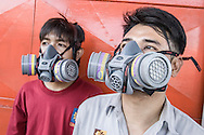 Thailand / Bangkok <br /> <br /> Un Lee factory , workers wearing safety mask <br /> <br /> © Daniele Mattioli China Corporate Photographer for Bystronic Switzerland