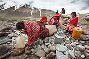 Kids getting water at the river. Daily life at the Khan (chief) summer camp of Kara Jylga...Trekking through the high altitude plateau of the Little Pamir mountains (average 4200 meters) , where the Afghan Kyrgyz community live all year, on the borders of China, Tajikistan and Pakistan.