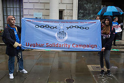 Activists from Uyghur Solidarity Campaign UK protest opposite the Chinese embassy in support of the Uyghur people's struggle for freedom on 5th August 2021 in London, United Kingdom. Activists highlighted the Chinese government's persecution and forced assimilation of Uyghurs, Kazakhs and other indigenous people in East Turkestan and Xinjiang and called for them to have the right to determine their own futures through a democratic process.