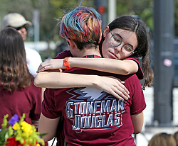 Students hug Thursday, February 14, 2019, outside Marjory Stoneman Douglas High School in Parkland, FL, USA, after the ceremony at 2:21 p.m. to mark the mass shooting at the school that killed 17 students and teachers on Valentine's Day last year. Photo by Charles Trainor Jr./Miami Herald/TNS/ABACAPRESS.COM