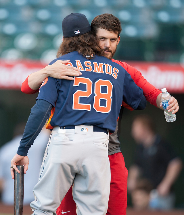 The Angels Cory Rasmus gives his brother Colby a hug after chatting before the Angels' 7-2 victory against the Houston Astros Friday night at Angel Stadium. <br /> <br /> ///ADDITIONAL INFO:   <br /> <br /> angels.0528.kjs  ---  Photo by KEVIN SULLIVAN / Orange County Register  -- 5/27/16<br /> <br /> The Los Angeles Angels take on the Houston Astros Friday at Angel Stadium.