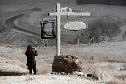 © Licensed to London News Pictures. 11/04/2021. Builth Wells, Powys, Wales, UK. A farm signpost is blasted with snow in an unseasonal wintry landscape on the Mynydd Epynt range near Builth Wells in Powys, Wales, UK. Photo credit: Graham M. Lawrence/LNP