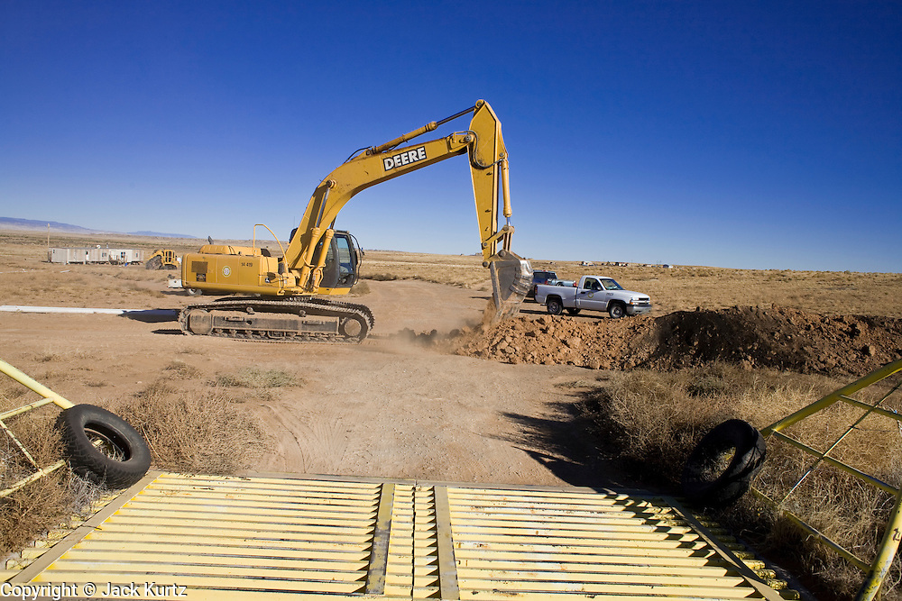 22 OCTOBER 2007 -- COYOTE CANYON, NM: Construction crews install water pipes on the Navajo Indian Reservation near Coyote Canyon. The project is a part of an effort by the tribe's government to bring potable water to the members of the Navajo Nation. More than 30 percent of the homes on the Navajo Nation, about the size of West Virginia and the largest Indian reservation in the US, don't have indoor plumbing or a regular supply of domestic water. Many of these homes have to either buy water from commercial vendors or haul water from public wells. A Federal study showed that the total cost of hauling water was about $113 per 1,000 gallons. A Phoenix household, in comparison, pays just $5 a month for up to 7,400 gallons of water. The lack of water on the reservation means the Navajo are among the most miserly users of water in the United States. Families that have to buy or haul water use only about 15 gallons of water per day per person. In Phoenix, by comparison, the average water use is about 170 gallons per day.  Photo by Jack Kurtz/ZUMA Press