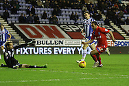 Bradley Dack rounds the keeper during the Sky Bet League 1 match between Wigan Athletic and Gillingham at the DW Stadium, Wigan, England on 7 January 2016. Photo by Pete Burns.