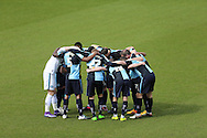 Wycombe Wanderers players huddle before k/o. Skybet football league two match, Wycombe Wanderers  v AFC Wimbledon at Adams Park  in High Wycombe, Buckinghamshire on Saturday 2nd April 2016.<br /> pic by John Patrick Fletcher, Andrew Orchard sports photography.