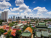 24 AUGUST 2014 - BANGKOK, THAILAND: The skyline of Thonburi seen from the Chee Chin Chor pagoda in Thonburi. Wat Thong Noppakhun, one of the oldest temples in Bangkok is in the foreground. Chee Chin Khor Moral Up-Lifting for Benefiction Foundation in a Chinese style temple on the Thonburi side of the Chao Phraya River in Bangkok. It blends aspects of Taoism, Buddhism (both Theravada and Mahayana), Islam, and Christianity religious traditions. Members of the temple perform community services throughout Bangkok.       PHOTO BY JACK KURTZ