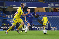 AFC Wimbledon striker James Hanson (18) battles for possession with George McEachran of Chelsea (55) during the EFL Trophy match between U21 Chelsea and AFC Wimbledon at Stamford Bridge, London, England on 4 December 2018.