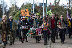 Uxbridge, UK. 1 February, 2020. Environmental activists from Stop HS2, Save the Colne Valley and Extinction Rebellion campaigning against the controversial HS2 high-speed rail link arrive in Uxbridge during a 'Still Standing for the Trees' march from the Harvil Road wildlife protection camp in Harefield through Denham Country Park to three addresses closely linked to Boris Johnson in his Uxbridge constituency. The Prime Minister is expected to make a decision imminently as to whether to proceed with the high-speed rail line.