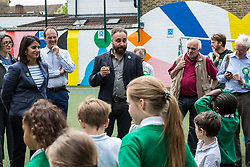 London, UK. 22 May, 2019. Scott Ainslie and Gulnar Hasnain, who top the Green Party list in London, join pupils from Bessemer Grange Primary school in visiting Goose Green Primary school in East Dulwich and the green pollution screen which local Green Party members helped to plant during campaigning for the European elections. Green Party MP Caroline Lucas also attended.