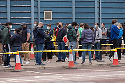© Licensed to London News Pictures. 19/06/2021. London, UK. Hundreds of adults over 18 year old queue outside Bridge Park Community Centre in Brent to receive a Covid vaccination. People had been queuing since 08:00am with up to 2,700 vaccinations available. The event is part of a mass vaccination drive as UK scientists have commented on signs of a third Covid wave underway due to the B.1.617.2 strain or Delta variant of Covid. Photo credit: Ray Tang/LNP
