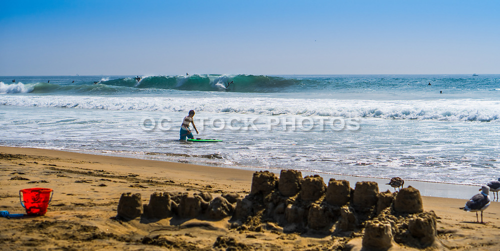 Kid Along the Shore With His Boogie Board