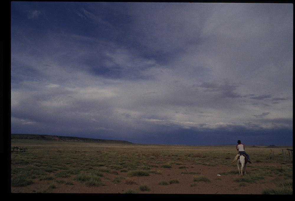 Vietnam veteran and Greasewood resident Paul Keams before his Blackening Way Ceremony.  Riding out behind his home in search of his grazing sheep.  1993