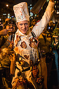 "New York, NY, October 31, 2013. A man in a chef's outfit captioned ""Deli Man"" and festooned with human body parts in the Greenwich Village Halloween Parade."