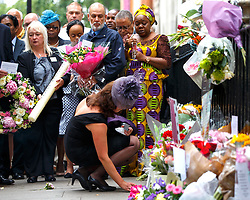 © Licensed to London News Pictures. 07/07/2015. London, UK. Families of 7/7 London bombings victims pay their respects on the 10th anniversary of 7/7 London bombings in Tavistock Square on Tuesday, July 7, 2015. Photo credit: Tolga Akmen/LNP
