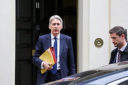 """© Licensed to London News Pictures. 20/03/2019. London, UK. Philip Hammond - Chancellor of the Exchequer departs from Number 11 Downing Street to attend Prime Minister's Questions (PMQs) in the House of Commons. According to No 10 Downing Street, later today Theresa May will write to European Union chiefs requesting a """"short"""" delay to the date Britain leaves the EU. Photo credit: Dinendra Haria/LNP"""