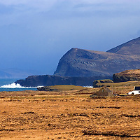 Valentia Island Cliffs with lonely white Cottage and ruin, Co. Kerry, Ireland / wl059