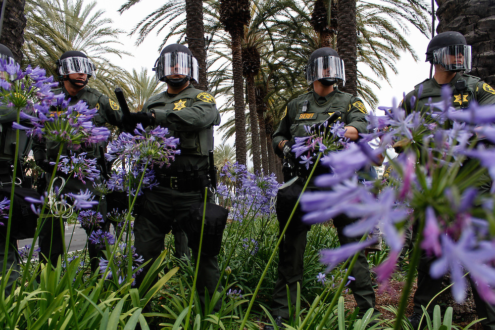 Riot police line pushing back Anti-Trump protesters on May 25, 2016 in Anaheim, California.
