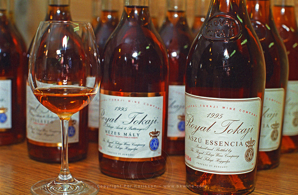 """The Royal Tokaji Wine company in Mad: Bottles of Tokaji Mezes Maly 1995 5 puttonyos, and the rare Aszu Essencia 1995, and a tasting glass. The RTWC in was one of the first Tokaj wineries to be """"revived"""" by an injection of foreign capital. It makes wine in a traditional style. Credit Per Karlsson BKWine.com"""