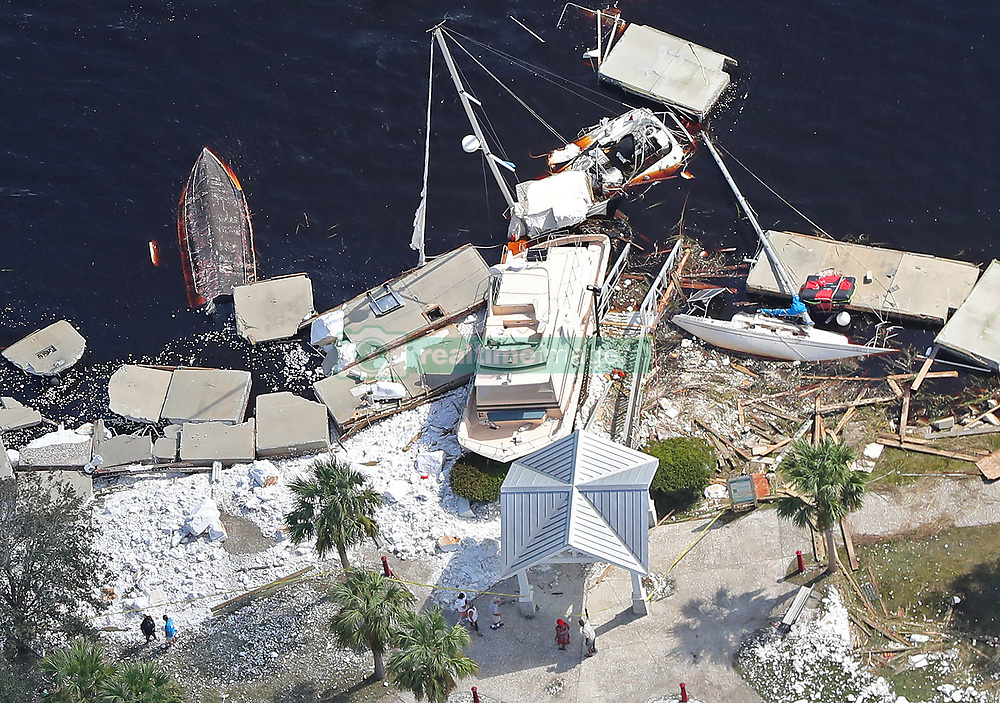 Local residents walk past debris from docks that were shredded and boats that were sunk littering the shoreline after Hurricane Irma passed on Tuesday, September 12, 2017, at St. Marys on the Georgia coast. Photo by Curtis Compton/Atlanta Journal-Constitution/TNS/ABACAPRESS.COM