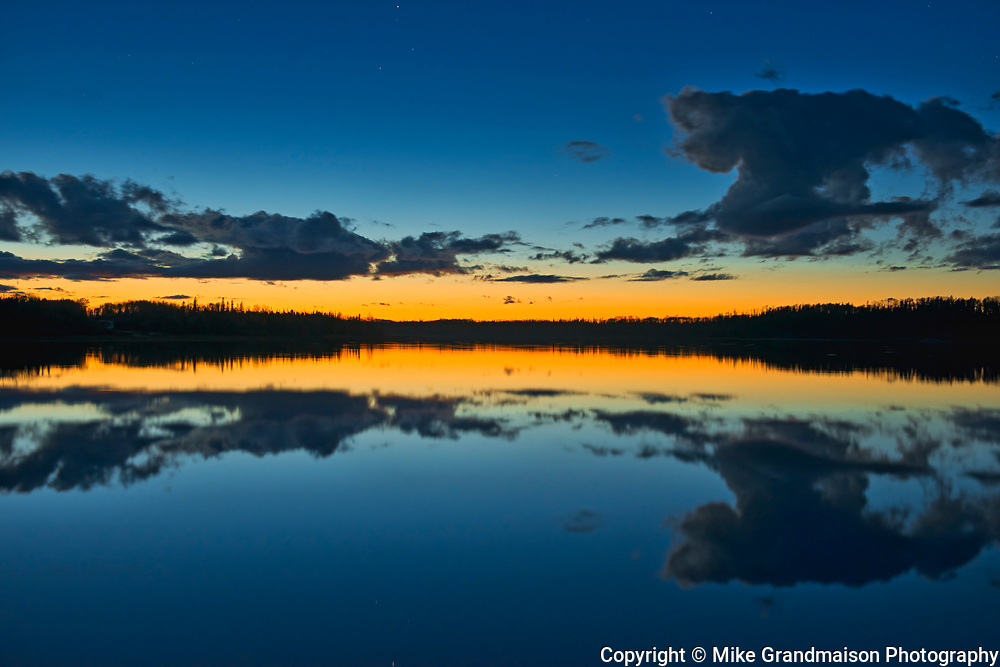 Clouds reflected in Klotz Lake at dusk<br />Klotz Lake near Longlac<br />Ontario<br />Canada