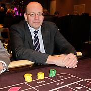 NLD/Schveningen/20120307 - Heropening Holland Casino Scheveningen, staatsecretaris Fred Teeven van Veiligheid en Justitie aan de roulettetafel