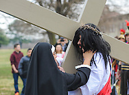 Roberto Marquez, of Bensalem, Pennsylvania portrays Jesus as meets his mother during the Stations of the Cross leading to his crucifixion on Good Friday April 3, 2015 at Our Lady of Fatima in Bensalem, Pennsylvania.  (Photo by William Thomas Cain/Cain Images)