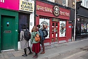People outside the Crobar rock and roll pub in Soho, London, United Kingdom.