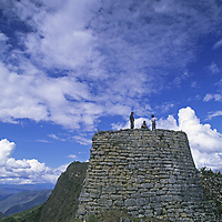 Travelers in Peru's Cordillera Central stand atop one of the fortress walls at Kuelap, a stronghold of the pre-Incan Chachapoyan culture.