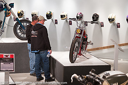 Checking out Karlee Cobb's custom Indian Scout in the Old Iron - Young Blood exhibition in the Motorcycles as Art gallery at the Buffalo Chip during the annual Sturgis Black Hills Motorcycle Rally. Sturgis, SD, USA. Wednesday August 9, 2017. Photography ©2017 Michael Lichter.