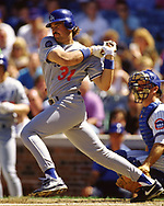 CHICAGO - 1993:  Mike Piazza of the Los Angeles Dodgers bats during an MLB game versus the Chicago Cubs at Wrigley Field in Chicago, Illinois during the 1993 season. (Photo by Ron Vesely) Subject:   Mike Piazza