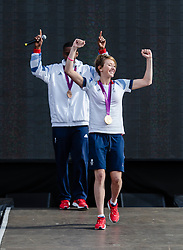 © Licensed to London News Pictures. 11/08/2012. London, UK.  Jade Jones and Lutalo Muhammed of the Team GB UK Taekwondo team who won Gold and Bronze respectively in the London 2012 Olympics.   Jade and Lutalo are onstage at Hyde Park to greet fans and show off their medals.  Photo credit : Richard Isaac/LNP