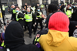 © Licensed to London News Pictures. 03/04/2021. London, UK. Police clash with Protesters in Parliament Sqsure during a Kill The Bill demonstration in central London. A number of campaign groups, including Sisters Uncut and Extinction Rebellion, have come together to form a 'Kill the Bill Coalition', which opposes the introduction of the Police, Crime, Sentencing and Courts Bill. Photo credit: Ben Cawthra/LNP