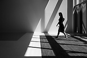 A student is silhouetted by sunlight as she enters the new Student Union West Wing at San Jose State University in San Jose, California, on August 25, 2014. (Stan Olszewski/SOSKIphoto)