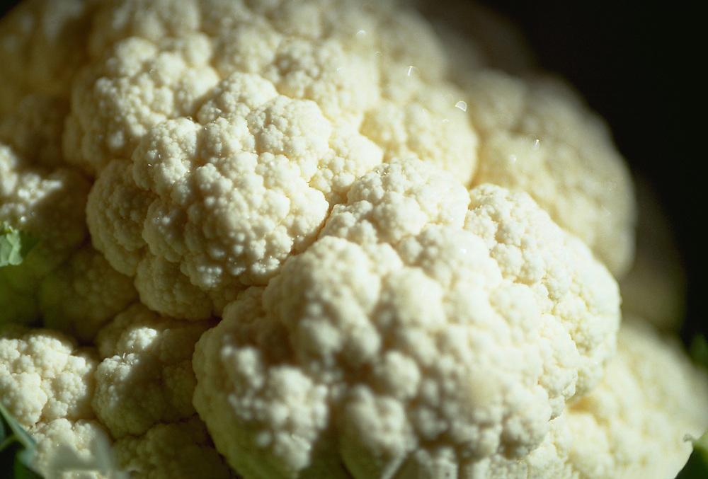 Close up selective focus photograph of a head of fresh cauliflower