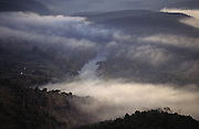 HUNTING WILD BOAR, France. Mist over the hills and cloud in the valley. Ardeche. Wild boar & deer hunting with hounds. A pursuit which is loved by some and hated by others. The hunters say hunting is natural, their opposers say it is bloodthirsty. There are millions of guns and it is a popular bloodsport.