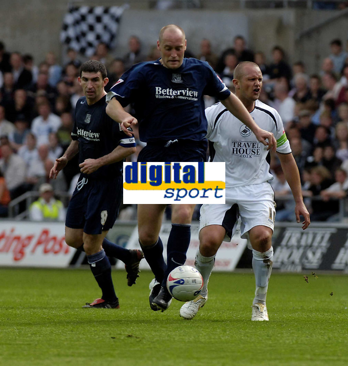 Photo: Adam Davies.<br />Swansea City v Southend United. Coca Cola League 1. <br />29/04/2006.<br />Southends Adam Barrett takes the ball from Swansea's Lee Trundle.