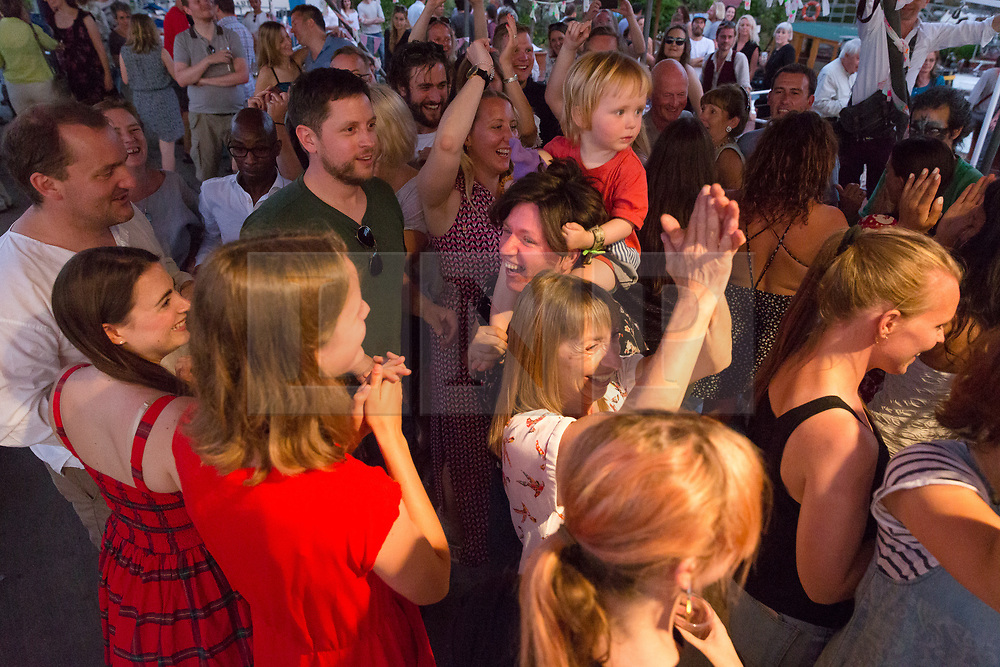 © Licensed to London News Pictures. 18/06/2017. LONDON, UK.  People dancing to the Diddy Dee folk band at The Great Get Together at Tower Bridge Moorings in London last night, 17th June 2017. Friends and residents from Hermitage Moornings, where Jo Cox lived on a houseboat with her husband and two children visited residents and friends at nearby Tower Bridge moorings on the River Thames. Photo credit: Vickie Flores/LNP