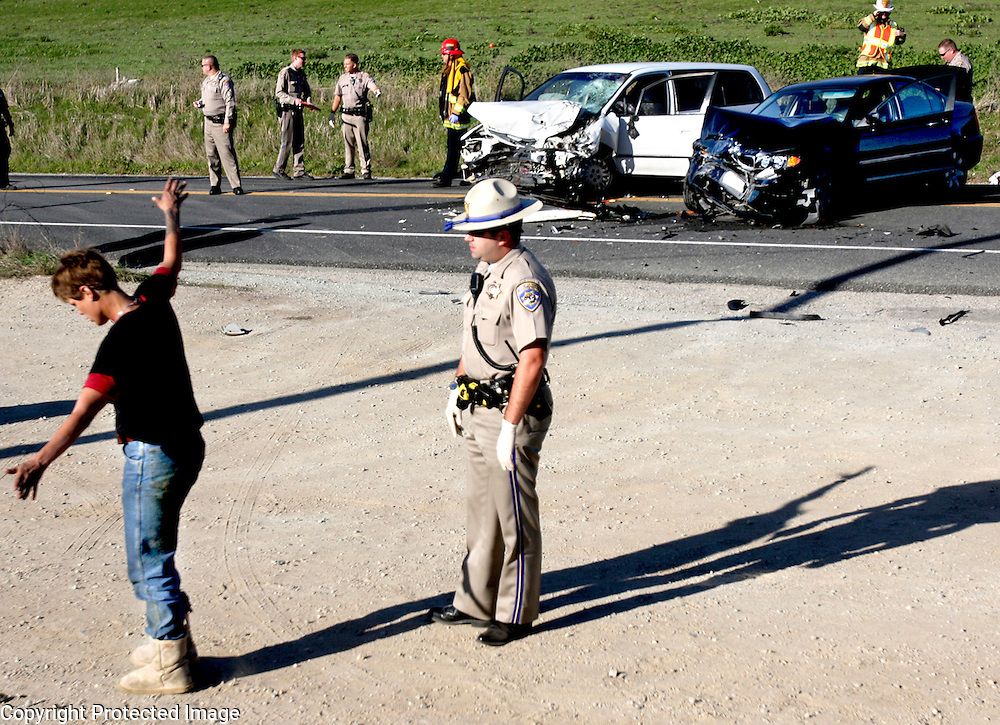 Highway patrol officer Grant Boles administers a field sobriety test to Sherri Chinn, who was later arrested for driving under the influence in connection with a fatal crash on Highway 1 south of Davenport, California. Chinn veered into oncoming traffic in her white Honda van, hit a motorcyclist head on before slamming into a black BMW driven by the motorcyclist's wife..  The motorcyclist died at the scene.<br /> Photo by Shmuel Thaler <br /> shmuel_thaler@yahoo.com www.shmuelthaler.com